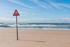 Danger label at the North Sea Stock Images