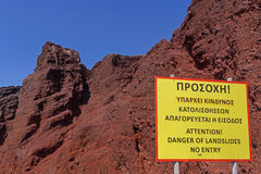 Danger of landslides board on Red Beach Stock Photo