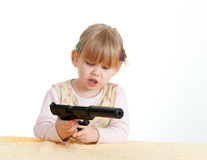 Danger - little girl with gun Stock Photos