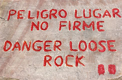 Danger, loose rock sign. In English and Spanish near Colca Canyon in Peru royalty free stock images