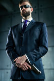 Danger man with gun. Danger man agent with gun and sunglasses. Focus on hands and gun Royalty Free Stock Photos