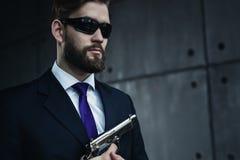 Danger man with gun Royalty Free Stock Images