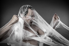 Danger. man tangled in huge white spider web Stock Images