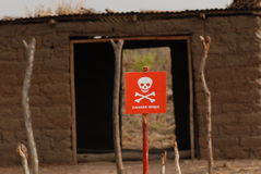 Danger mine sign in Southern Sudan. A danger mine sign and de-miner working in the Southern Sudan area of Juba Royalty Free Stock Photo