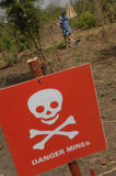 Danger mine sign in Southern Sudan. A danger mine sign in a villlage in the Southern Sudan area of Juba Stock Image