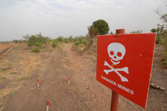 Danger mines. A land mine sign near a deserted  house in Southern Sudan Royalty Free Stock Photos
