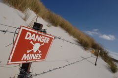 Danger mines sign. Minefield site in Falkland Islands Stock Photo