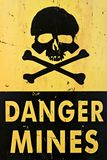 Danger mines warning sign closeup