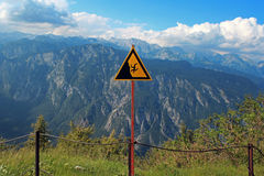 Danger in mountains. Warning sign of danger in mountains, Julian Alps, Slovenia stock photos