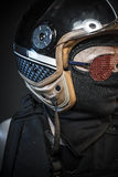 Danger, murderer with motorcycle helmet and guns Royalty Free Stock Photos