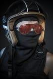 Danger, murderer with motorcycle helmet and guns Stock Photo