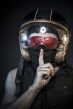 Danger, murderer with motorcycle helmet and guns Royalty Free Stock Images