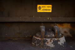 Danger near heavy industry. Danger sign warns about life hazard near heavy industry structure Stock Photo