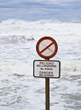 Danger No Diving. Sign with a stormy sea in the background. Signal written in Spanish and English Stock Photography