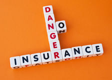 Danger no insurance. Text  insurance ,  danger  and  no  inscribed in uppercase letters on small white cubes and arranged crossword style with common letters  n Royalty Free Stock Image