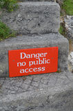 Danger no public access sign on stone step. Stock Images