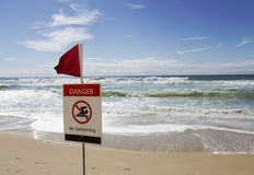 Danger no swimming horizontal. Rough surf beach at surfers paradise australia with danger sign Royalty Free Stock Photo
