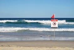 Danger - No Swimming sign. Danger no swimming sign on the beach, Gold Coast Australia stock photography