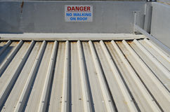 Danger no walking on roof sign. Royalty Free Stock Photography