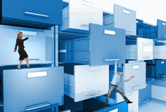 Danger in office. 3d image of open drawer of file cabinet with business people Royalty Free Stock Photography