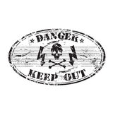 Danger oval stamp. Black grunge rubber oval stamp with skull shape, electricity symbols and the text danger keep out written inside the stamp Stock Photo