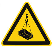 Danger overhead, crane load falling hazard risk sign, cargo icon signage, isolated black triangle over yellow, large macro closeup Royalty Free Stock Photo
