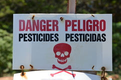 Danger Pesticides Peligro sign. Red and white Danger Peligro Pesticides Pesticidas Sign Stock Images