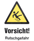 Danger plate. An isolated slippery warning plate Royalty Free Stock Photos