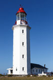 Danger Point Lighthouse. Is a lighthouse on the southern point of Walker Bay, near Gansbaai. It is a white octagonal masonry tower that has been in use since Stock Photo