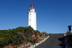 Danger Point Lighthouse. Is a lighthouse on the southern point of Walker Bay, near Gansbaai. It is a white octagonal masonry tower that has been in use since Royalty Free Stock Photo