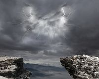 Danger precipice. On the mountain with rainstorm clouds and lightning Stock Image