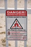 Danger Restricted Access. A sign reading Danger Restricted Access Strong Magnetic Field Stock Photo