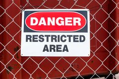 Restricted Area Danger. Danger, Restricted Area Sign on wire mesh fence stock photos
