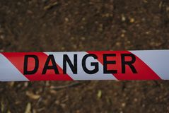 Danger ribbon with diagonal stripes stock image