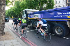 Danger and risk in cycle lanes. The danger from lorries encroaching into cycle lanes royalty free stock image
