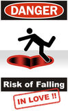"Danger: Risk of Falling in Love. Vertically framed, Photoshop Illustration, Using ""Danger: Falling in Hole"" safety sign for ""falling in love"" concept Stock Images"
