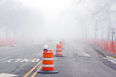 Danger on Road. Fog and Construction Stock Image