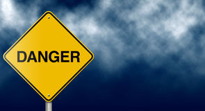 Danger Road Sign on Stormy Sky. Open-ended concept traffic sign meant to signal risk ahead stock photography