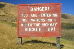 Danger road sign warning to buckle up! Stock Photos