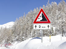 Danger road sign on a winter road Royalty Free Stock Images