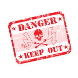 Danger rubber stamp. Grunge office rubber stamp with crossbones, electricity symbols and the text danger keep out, written inside the stamp Royalty Free Stock Photo