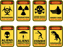 Danger sig. Vector warning humorous signs with sci-fi and rare hazards - vector set Stock Images