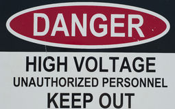 Danger sign. A sign stating of a high voltage danger and to keep out Stock Image