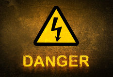 Danger sign. And text on grunge wall Royalty Free Stock Photography