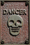 Danger sign. A danger sign on a textured red and grey background Stock Image