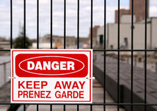 Danger Sign. A sign on a fence outside an industrial site. Ottawa, Ontario. Canada Royalty Free Stock Images