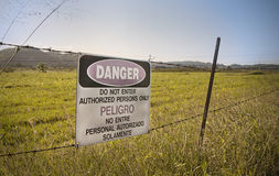 Danger Sign. Danger and no trespassing Sign in cow farm Stock Photography