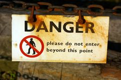 Danger Sign 67. A danger sign on a chain fence surrounding a dry dock in Liverpool Royalty Free Stock Photo