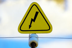 Danger sign. Yellow danger sign with lightning on electric fence royalty free stock photos