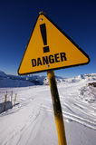 Danger sign in alps avalanche area. Danger sign warning about avalanche area Royalty Free Stock Photo